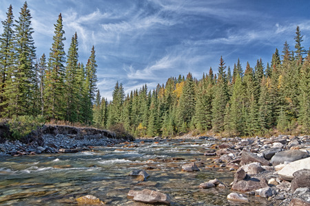 A cool blue landscape of the Sheep River in Alberta, Canada. Stock Photo
