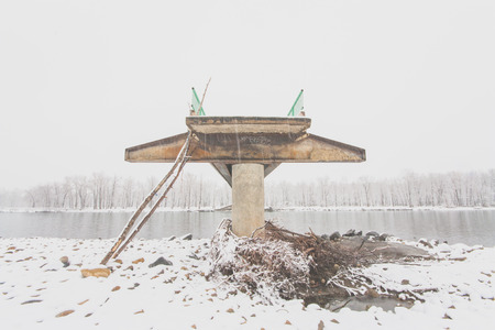 sue: Landscape of the front view of a flood damaged bridge in winter.