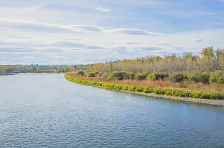 Autumn landscape of the Bow River in Fish Creek Park, Calgary. Alberta.