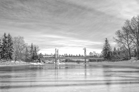 eau: Monochrome winter landscape of a skating rink and the Jaipur Bridge, Calgary, Alberta.