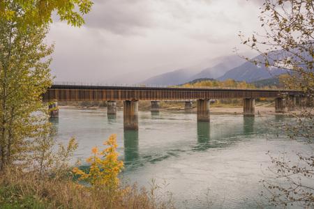 Landscape of the CP rail bridge over the Columbia River in Revelstoke, British Columbia. Stock Photo