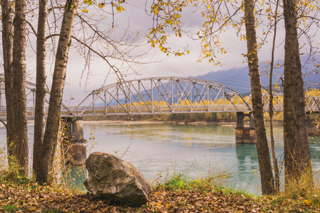 eddy: Landscape of Revelstokes Big Eddy Bridge in Autumn.