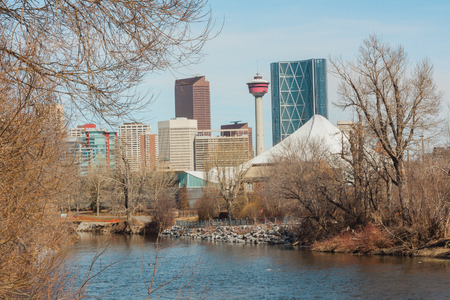 Cityscape of Calgary, Alberta Canada with the Elbow river in the foreground.