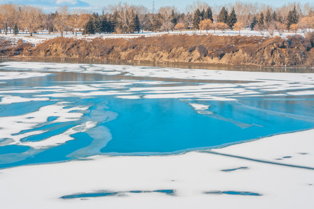 A winter landscape of patterns on an icy Glenmore Reservoir. Stock Photo