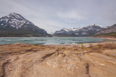 Spring hike scenery of textured ground, Barrier Lake and Mount Baldy.