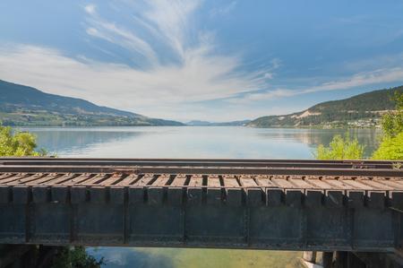 Landscape of Wood Lake from a small train bridge in Oyama, British Columbia.