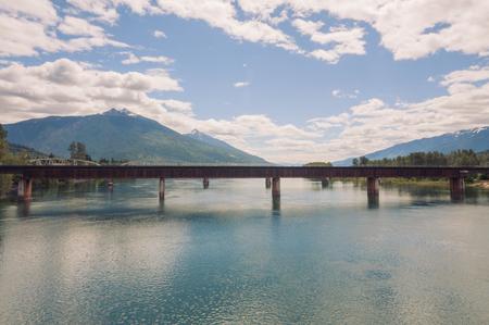 Landscape of the train bridge crossing the Columbia river in Revelstoke British Columbia.