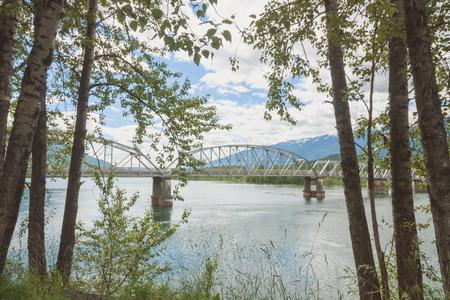 Landscape of tree framed Big Eddy Bridge in Revelstoke, British Columbia