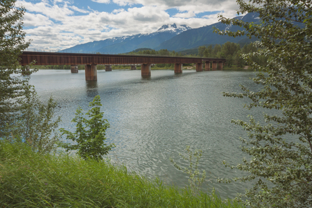 Landscape of the Revelstoke train bridge over the Columbia River in British Columbia
