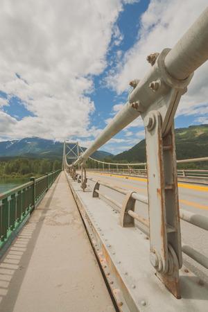 Image on top of Columbia River Bridge ( Revelstoke Bridge) with no traffic on highway 1. Stock Photo