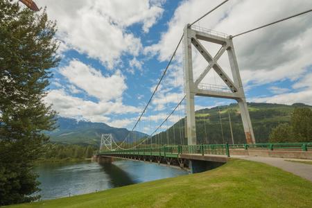 Majestic Columbia River Bridge (Revelstoke Bridge), surrounded by mountains.