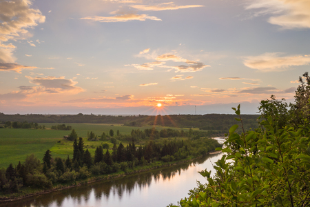 Landscape of the sun setting above the Red Deer river in Red Deer, Alberta.