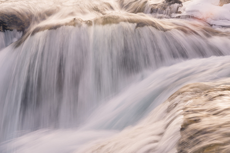 Close-up of the motion of the fast water flow of the Elbow Falls