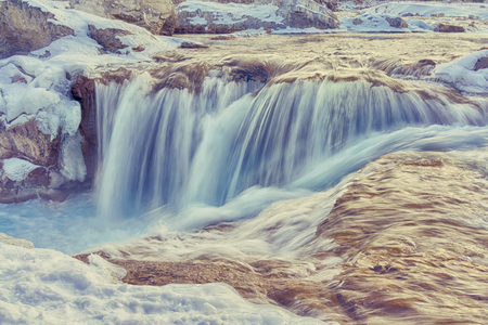 Landscape of the raging water of Elbow Falls in Winter. Stock Photo