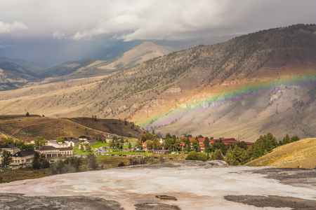 Rainbow over Mammoth Community in Yellowstone National Park, Wyoming, USA.