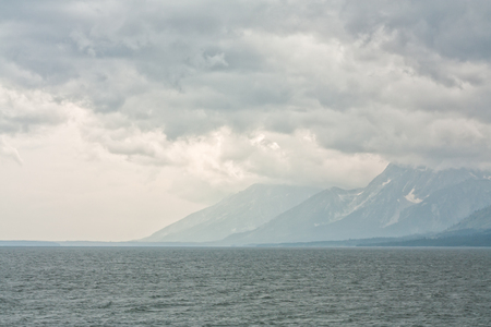 Stormy skies over the water of Yellowstone Lake, Yellowstone National Park, Wyoming, USA.