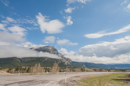 View of on ramp to Highway #1 with Grotto Mountain in the background, Kananaskis, Alberta, Canada.