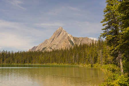 Landscape of Cone Mountain with Watridge lake in the foreground, Kananaskis, Alberta 写真素材 - 106703702