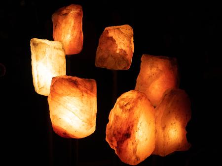 Salt crystal with lamp backside Фото со стока