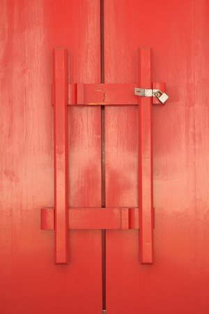 Red door of church with wood latch photo