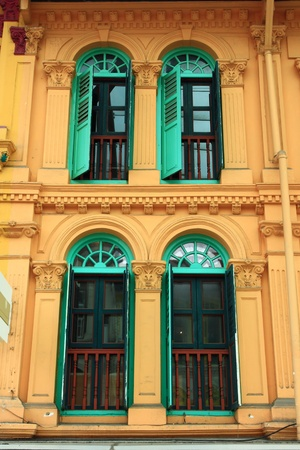 Green wooden windows from singapore china town. Stock Photo