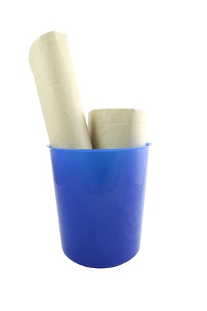 Blue plastic bucket and waste on white background.