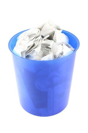 Waste paper in blue plastic trash isolated. Stock Photo - 11043928