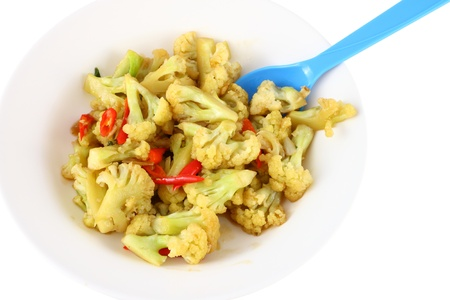 Cauliflower fried with chili and blue spoon. Stock Photo