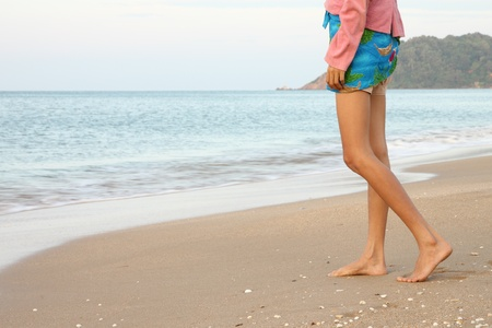 Walking to the sea in morning on beach. Stock Photo