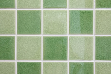 Green tone mosaic tiles glossy bathroom wall. Stock Photo