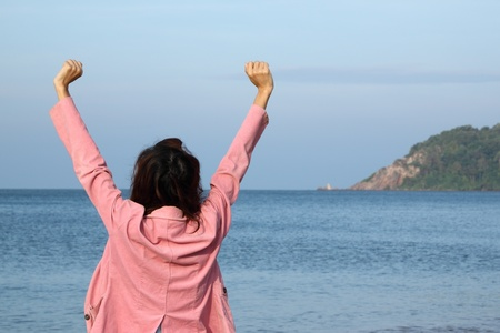 exult: Reach to the sea shore on vacation. Stock Photo