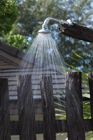 Flowing water of outdoor shower in tropical resort.