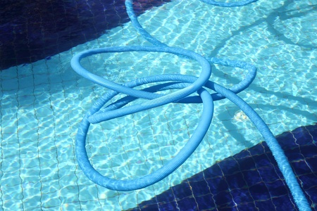 Pool cleaning pipe floating.