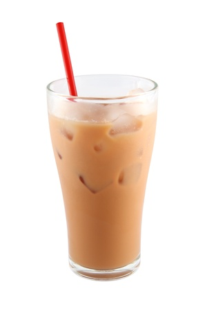 Ice milk tea with red straw on white background. Stock Photo
