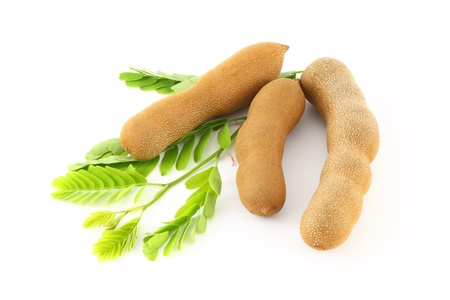 Three tamarind on green leaf. Stock Photo