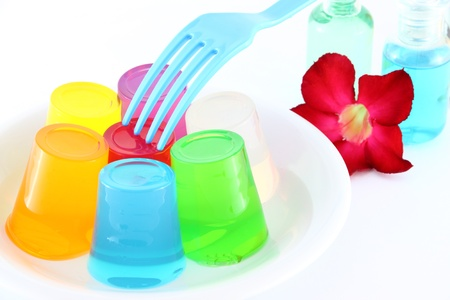 Multiple cold jellies on dish and blue fork. Stock Photo - 11830365