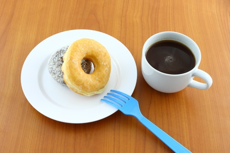 Sugar and chocolate donut on breaking time. photo