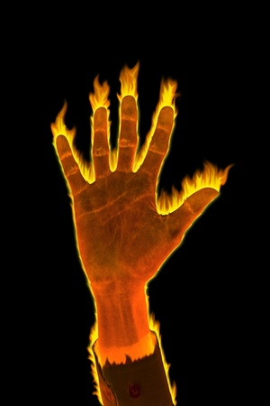 Hand of fire business man glow in the dark. Stock Photo