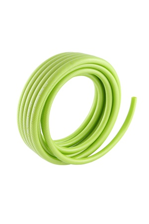 Vertical roll of green pvc garden hose on white background. Stock Photo