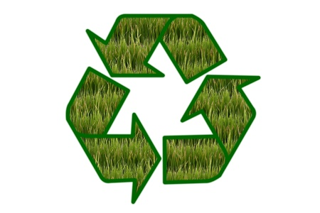 Recycle sign contain green field on white background  photo
