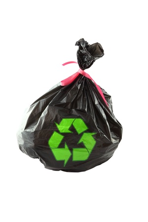 Black plastic garbage bag and recycle sign on white background  photo