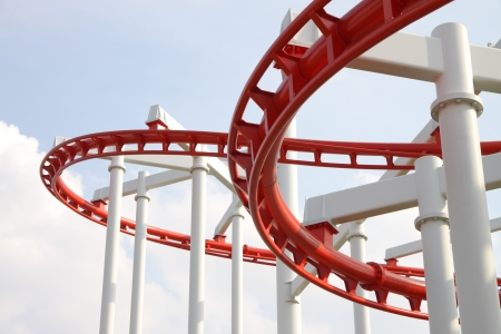 metal structure: Curve of red and white roller coaster.