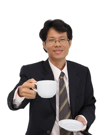 Coffee serving from business man focus at cup on white background. Stock Photo - 15785854