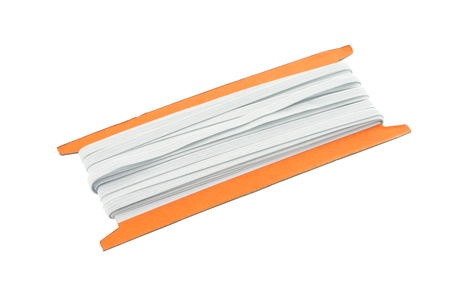 elastic band: Old elastic band roll on white background. Stock Photo