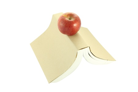 cover up: Apple on brown cover up side down book   Stock Photo
