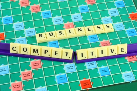 Business wording in queue scrabble on game board.