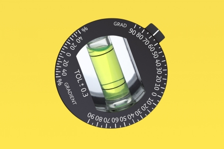 Water level angle measurement on yellow ruler.