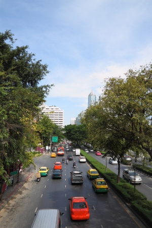 Street avenue with traffic before intersection. Stock Photo