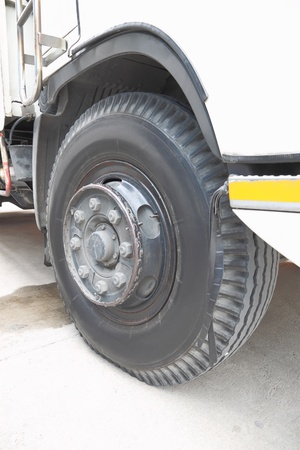 Old front wheel of truck on cement road. Stock Photo - 16883311