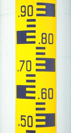 depth measurement: Water level scale sticked plastic pole. Stock Photo